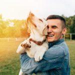 Man holding happy dog