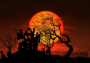 Spooky Halloween House on hill with tree against harvest moon.