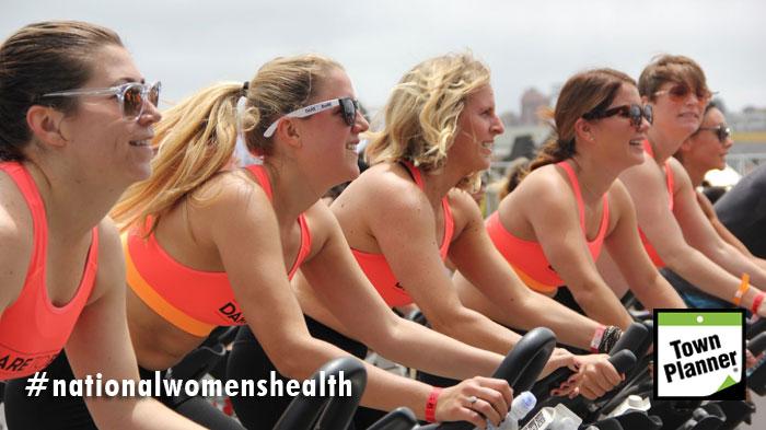 Women exercising on stationary bikes