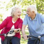 Senior Man and Woman riding bikes