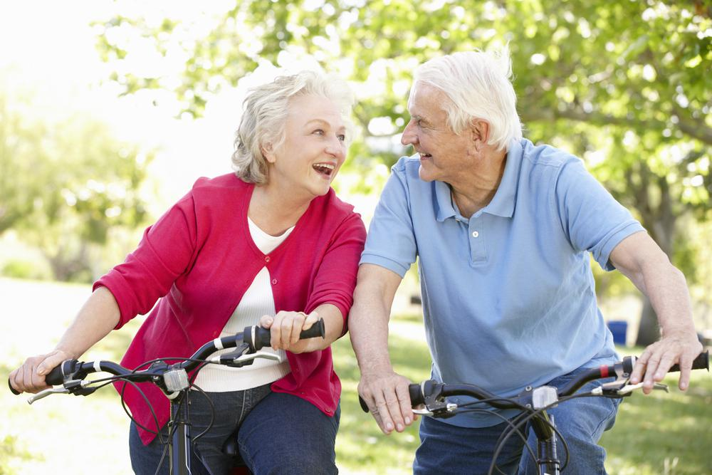 Senior Man and Woman riding bikes